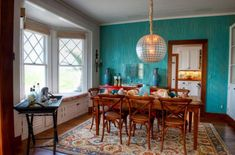 A turquoise accent wall makes a strong statement in any space