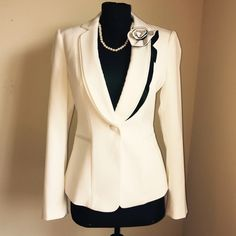 White Blazer Black & White Ruffle Rose Lapel White Blazer with Black & White Detachable Ruffle Rose Design on Lapel The rose design comes off transforming it to a classic white blazer Never Worn 2 Extra Buttons Included  No Price Negotiations in Comments • No Lowball Offers • Discounted Shipping on Agreed Offer/Counteroffer No Trades • No Holds White House Black Market Jackets & Coats Blazers