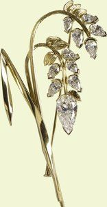 The Botswana Flower Brooch -- Depicting a spray of sorghum (or millet) with 11 pear shaped diamonds and gold, this delicate brooch was given to Queen Elizabeth II by the President of Botswana, Festus Mogae, during the 2007 Commonwealth Heads of Government Meeting. The plant is a major crop for Botswana. Though the brooch was exhibited in 2009, I believe its first public outing was not until the 2014 state visit to France.