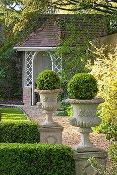 ♔ Garden Urns at Grange Court, Guernsey - photo by Clive Nichols