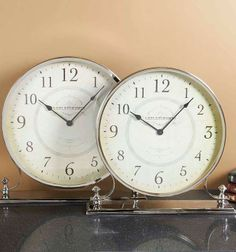 Never lose track of time with our Set of 2 Leblanchemin Desk Clocks.