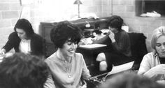 This 1962 yearbook image released by Wellesley College shows Nora Ephron, editor of the Wellesley News in the newsroom at Wellesley College in Wellesley, Mass