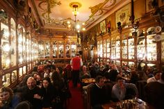 Lisbon, Portugal -Pavilhão Chinês is one of the most eccentric bars in the city. The walls are covered in cabinets filled with toys, dolls, hats, helmets and other paraphernalia.