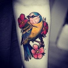Drawn in the classic, colorful style, this tattoo shows a yellow robin sitting amid a bunch of flowers. It is sitting on a twig with the flowers behind and in front of it. The bird is vividly colored in yellow, blue and pink. Et Tattoo, Samoan Tattoo, Flower Tattoos, Small Tattoos, Bluebird Tattoo, Tattoo Bird, Blue Tit Tattoo, Robin Tattoo, Bird Tattoos For Women