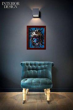 blue velvet chair with artwork MountainQueen