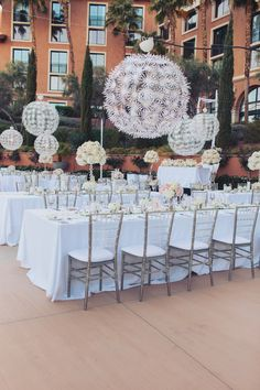 Long banquet tables were dressed with White Duping linens topped with mirrored table runners, high and low white and blush centerpieces, and scattered candles.  Lucite Chiavari Chairs with ivory cushions surrounded the tables, and pashminas were placed for the ladies if they felt a chill. Las Vegas Wedding Planner Andrea Eppolito  |  Wedding at Lake Las Vegas  | White and Blush and Grey Wedding