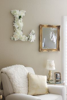 This DIY floral letter is such a pretty touch in this gold, glam baby girl nursery!