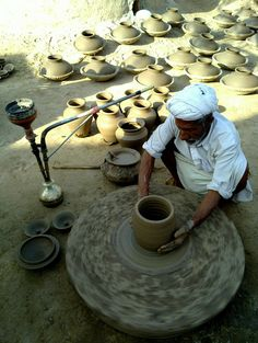 Nostalgic Pakistan | A potter busy making Clay, wheel thrown pottery.