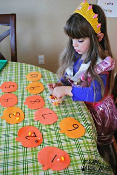 When you're not enjoying a little television R&R with your little one this October, try opting for a Halloween math activity with Candy Corn Counting!