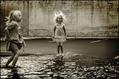 The joy of jumping in puddles... :) Every summer I'd beg Mom to let me out when it rained. I loved it!