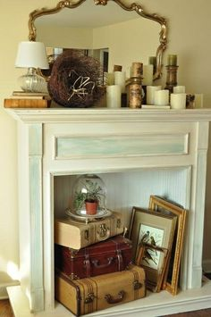 staging vignettes in a faux fireplace