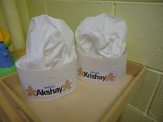 Make baker's hats using paper, and a good quality paper napkin or paper towel as the top. Add their name too.