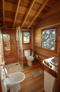 Suite Blue, part of Hotel La Piantata, is a project designed by La Cabane Perchée. This treehouse is located in Arlena di Castro, Italy. Suite Blue by La Cabane Rest House, House In The Woods, Cabin Design, Tiny House Design, Cabin Homes, Log Homes, Wooden Tree House, Cabin Bathrooms, A Frame House