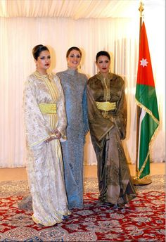 (C) Queen Rania of Jordan receiving Princess Lalla Meryem (R) and Lalla Soukaina in 2002