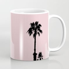 Palm Tree Silhouettes On Pink Mug by ARTbyJWP in Society6 #pink #palmtrees #palm #palmtree #palms #silhouettes #mug #mugs #coffeemug #artprint #artprints #buyart #artbyjwp #society6 #shopgifts #gift #gifts #giftideas - Available in 11 and 15 ounce sizes, our premium ceramic coffee mugs feature wrap-around art and large handles for easy gripping. Dishwasher and microwave safe, these cool coffee mugs will be your new favorite way to consume hot or cold beverages.