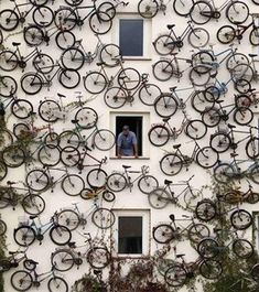 Bikes all over wall | outdoor art installation | Exterior Design | Repurpose bike ideas