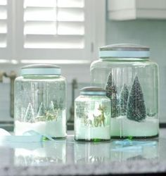 Instant snowglobes: Place artificial snow (or even sugar!) to the bottom of clear canisters, apothecary jars, or canning jars. Add miniature trees, reindeer, or your favorite ornaments to create a snowy scene. | http://www.livingthecountrylife.com/homes-acreages/country-homes/15-ways-bring-christmas-kitchen/