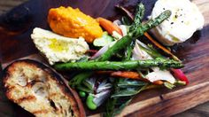 AOC: The Farmer's Plate comes with spring vegetables, carrot puree, fava puree, bur rata and grilled toast.