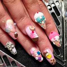 Good enough to eat:Amber Trawick, a nail artist on the Oxygen network's…