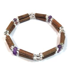 Hazelwood Amethyst Double Bracelet (cube / round)! Effective in reducing acid-based ailments and symptoms, such as eczema, acid-reflux, and heartburn, and ulcers. Must be placed directly on the skin and worn 24/7. Made with nylon-coated steel wire, hazelwood and assorted beads on elastic (no clasp).