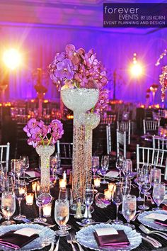 Beautiful Wedding Center Pieces by Forever Events  SALLY: Love the crystal vases; but change the color of flowers.