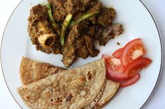 Sindhi Seyal Gosht (Spiced meat curry cooked with cardamom, chilli and caraway seeds)