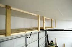 Great how-to on putting that unused space above the garage door to work!