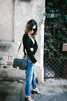 casual + chic look in black and distressed denim via For All Things Lovely | Revolve top, Zara distressed jeans, Valentino shoes, Chanel handbag, David Yurman bracelet stack and David Yurman rings | Charleston, SC
