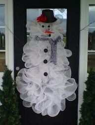 mesh snowman wreath - made from 3 graduating sizes of wreaths tied 1 to the other, then use mesh as usual and add decorations. She used feathers for the rim of the hat and a ski hat stuffed with plastic bags for the top of the hat. material/buttons for eyes buttons; material for scarf; twigs for arms.