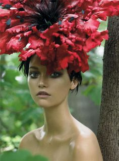 Garden of Delights Vogue US, December 2006 Photographer: Steven Meisel Model: Gemma Ward Giant Poppy headpiece by Philip Treacy Gemma Ward, Steven Meisel, Grace Coddington, Ellen Von Unwerth, Philip Treacy Hats, Caroline Trentini, Sasha Pivovarova, Karen Elson, Vogue Us