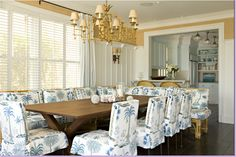 Faux bamboo chandelier, straw-colored grasscloth & blue/white slips - so lovely!  James Radin