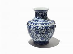 Porcelain, cobalt China, Qing Dynasty (1644-1911) Bearing Qianlong reign mark on the underside Dimensions (height x width): 19 1/2 x 17 3/4 in. (49.5 x 45.1 cm) Good condition  This blue and white porcelain globular vase with Qianlong marks and applied lion mask handles features the eight Buddhist emblems. The vase also displays scrolled waves, lotus blossoms, lotus petals and lotus meander.  This vase is in good condition with light use wear and dirt residue. It measures 19 1/2 x 17 3/4 in…