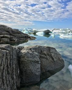The sea calm as a mirror icebergs floating around Iike they are mimicking the clouds sun is shining... it just can't get any better!  #greenlandpioneer #wanderful_places #splendid_earth #nofilterneeded #savoteur #addressplanetearth #happytrailz #nature_prefection #nature_obsession_landscapes #sky_perfection #reflection_shotz #reisefieber #weltenbummler #greenland #ilulissat #ilulissaticefjord #thenomadgram #getoutandtravel #reflectiongram #wanderlusting #globalglimpses #roamtheplanet…