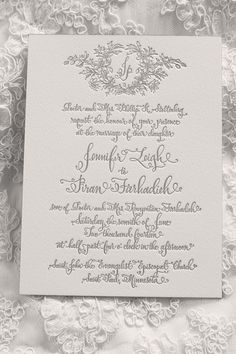 very pretty calligraphy and layout. like the idea of the monogram at the top, but maybe with a smaller wreath or floral design