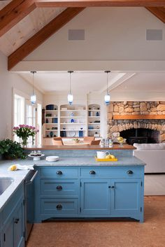 Love the cabinet color & wood burning stove with fireplace surround