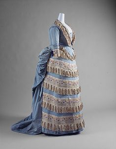 Ball gown, side view.  House of Worth(French, 1858–1956),  Designer: Charles Frederick Worth.  Date: ca. 1872.  Culture: French.  Medium: silk.  Dimensions: Length at CB (a,b,c): 55 in. (139.7 cm) Length (c): 23 in. (58.4 cm).  Credit Line: Gift of Mrs. Philip K. Rhinelander, 1946.