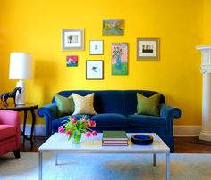 Minimalist Living Room Interior Decorating Ideas With Yellow Wall Paint Color And Blue Velvet Sofa And White Coffee Table Furniture Above White Fur Rug