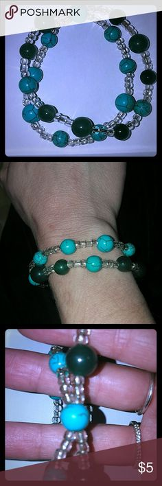 *Turquoise Double Strand Bracelet* Turquoise & Jade-Colored beads alternatebwith clear beads that connect at one point (see pic#3) to make a stretchy double stranded bracelet! Cute & funky! Jewelry Bracelets