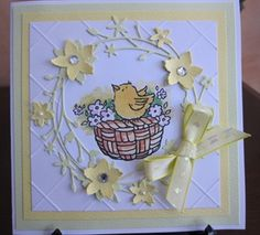 Easter card with Penny Black chick framed with Memory  box (?) flower wreath die