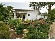 Landscaping with a gorgeous pond | 12775 West Watson Road, St Louis, MO 63127