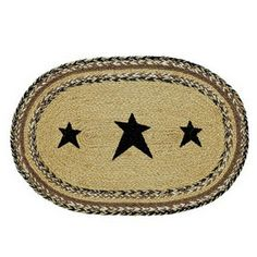 Kettle Grove Stencil Star Braided Placemats - Set of 6 - Ourline of braided rugs and tabletop decor items are always a big hit! Our Kettle Grove Stencil Star Braided Placemats sell as a set of six. These placemats are a blend of black, cream, and caramel brown colors with three black, primitive stars. Placemats are made from natural 100% jute. Do not machine wash. Spot clean with mild soap.