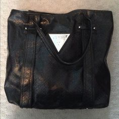Black Guess purse Black, leather-like Guess purse.  Very spacious!  Really cute Guess logo on front.  The purse measures about 17 inches wide and 14 inches tall. Guess Bags Shoulder Bags