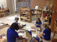 upper elementary Montessori students working with Archimedean solids (Lakeland Montessori in Lakeland, FL, USA)
