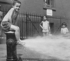 Kids cooling off in Brooklyn, New York, 1953.   I did it in the 80's. Still see this same scene today.  Ahh to grow up a city kid!