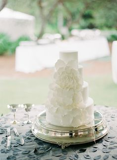 Wedding cake with white flowers by Confections on the Coast via Glamour and Grace