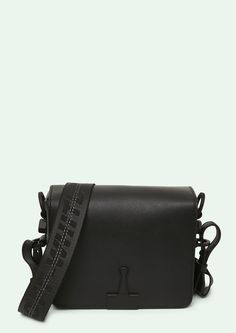 "Cross body leather flap bag in black with black ""TIE DOWN"" Industrial belt strap. ""SCULPTURE"" print at back. Height 17 cm. Width 19 cm. Depth 10 cm. Width shoulder strap 7 cm. Length ""TIE DOWN"" shoulder strap 162 cm."