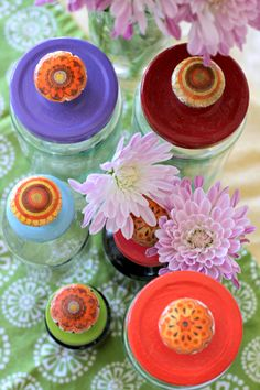 Recycled Jars with painted lids and faux ceramic knobs made from plain wood knobs, Mod Podge and Napkins
