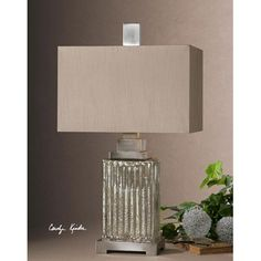 The base of thie modern lamp has Ribbed Mercury Glass.
