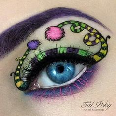 An artistic Dr. Seuss inspired makeup look made with Concrete Minerals shadows.