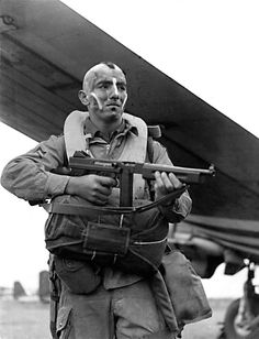 """Sergeant Jake McNiece of the 101st Airborne Division ready to drop into Normandy for the D-Day invasion (June 1944). He was a member of the original """"Filthy Thirteen"""", a group of paratroopers who would loosely inspire the movie THE DIRTY DOZEN. A member later remarked, """"We never washed a piece of clothing. We never shined any shoes or boots, and we didn't salute officers. We didn't go for any of that malarky, you know?"""""""